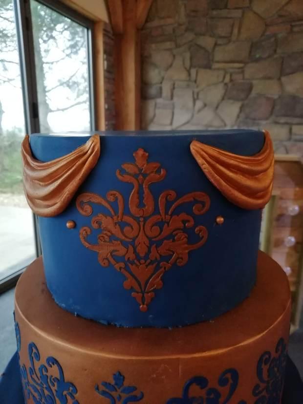 Top tier rose gold & royal blue wedding cake