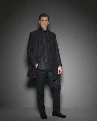 man wearing a black suit for Jaxson Maximus suit guide