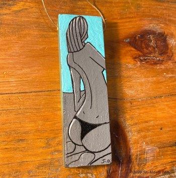 Figurative mini painting on wood of a girl in bikini bottoms