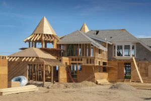 home addition under construction with plywood structure half finished