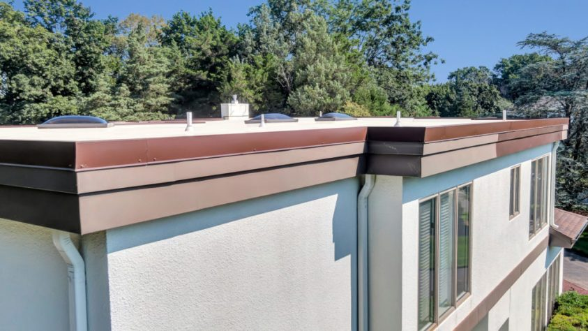 flat roof and gutters