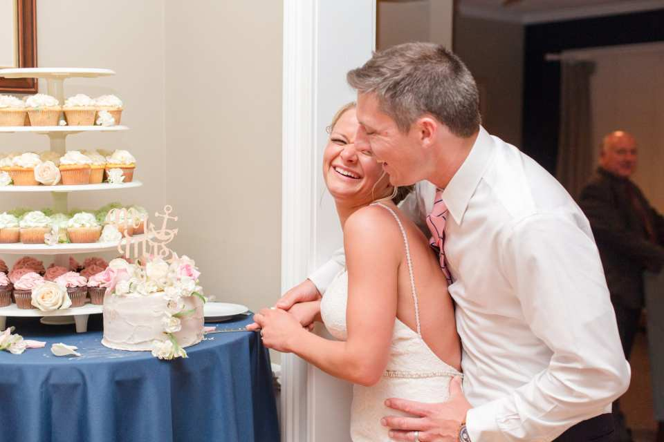 couple fun wedding cake photo