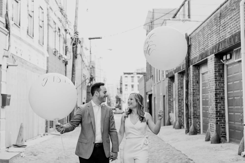 giant balloon engagement photo, black and white photo, incorporating props into engagement shoot, nj wedding photographer