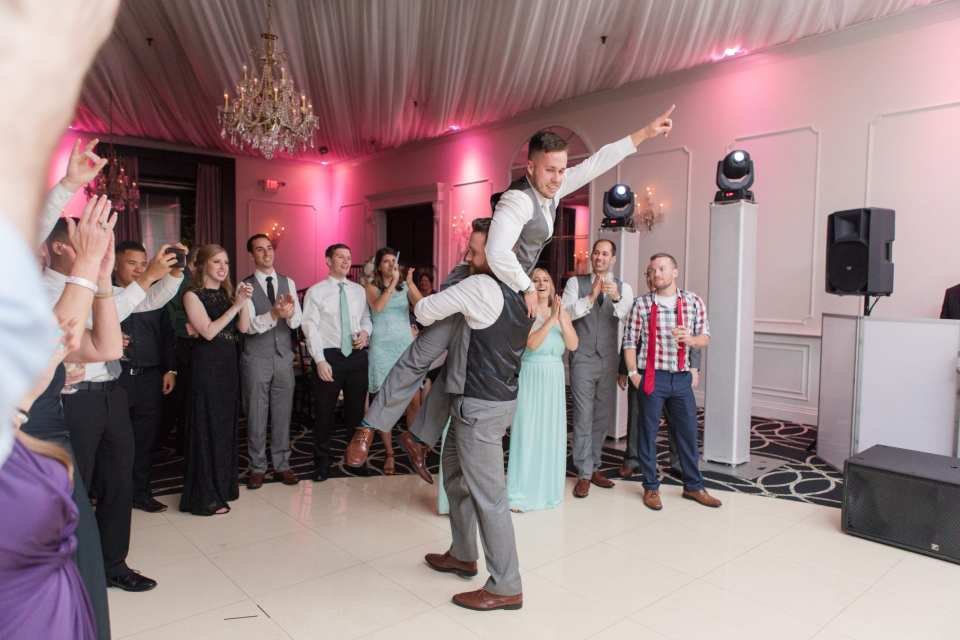 fun reception photos, groom dancing the night away