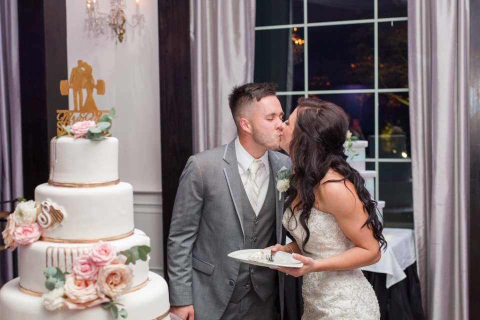 cake kiss, bride and groom kiss, elegant cake, 4 tier cake, Gramercy, Gramercy at Lakeside Manor, New Jersey wedding photographer