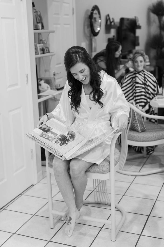bride receives a precious gift from groom black and white photo
