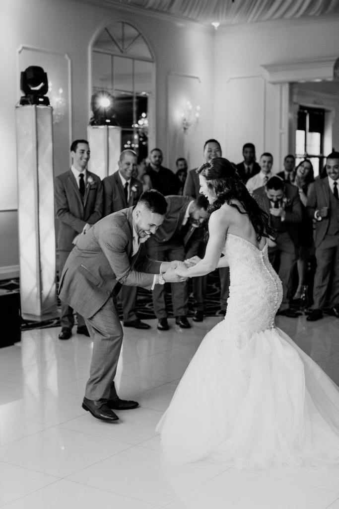 bride and groom fun first dance, black and white photo