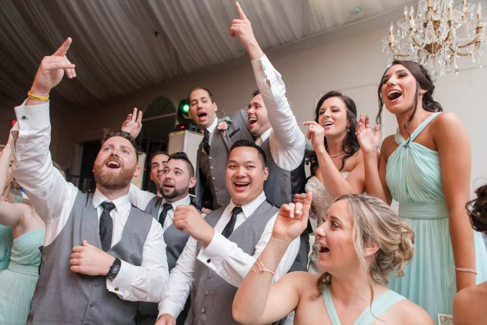 singing guests, lively guests wedding reception at the Gramercy at Lakeside Manor