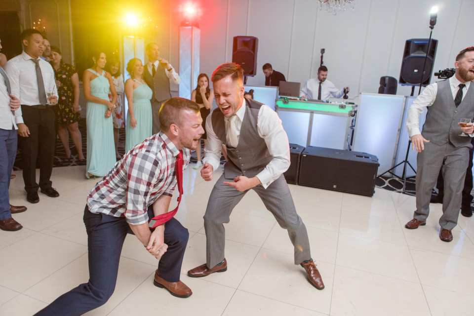 reception dancing photos, groom having fun