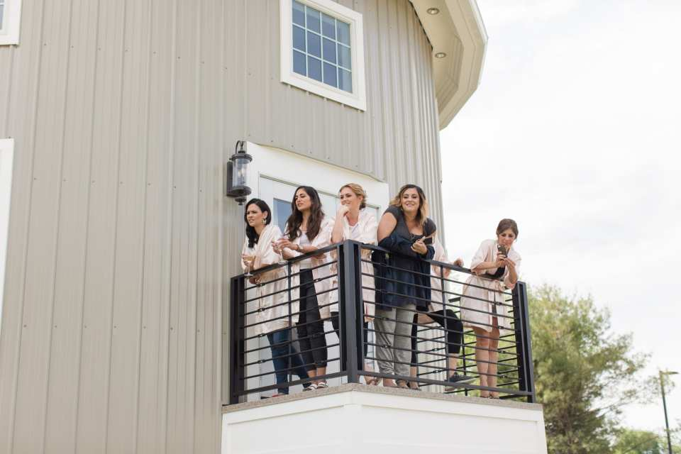 bridesmaids on the balcony of the bridal suite at Bear Brook Valley