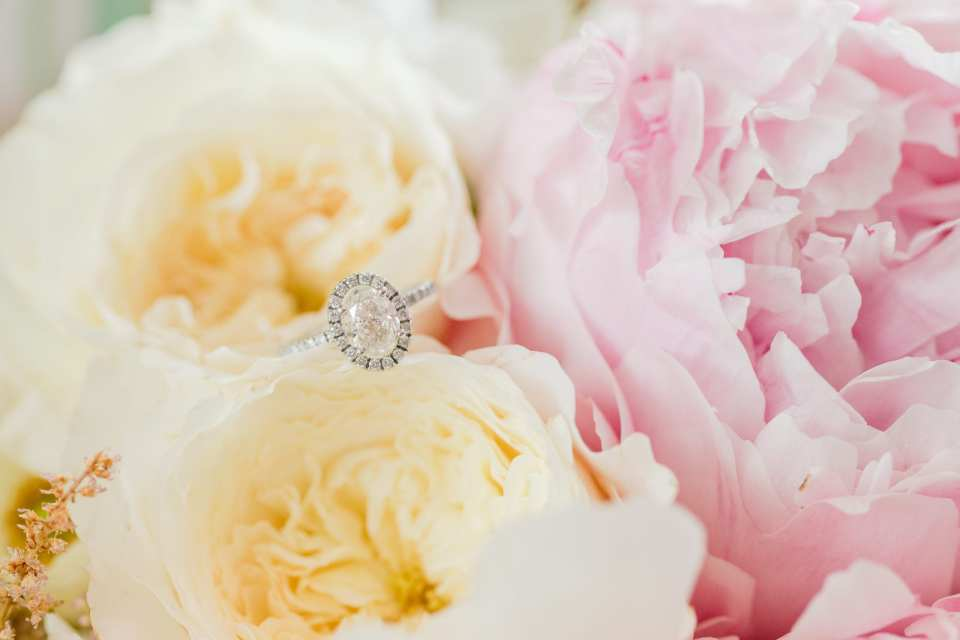pink and cream rustic bouquet flowers, oval diamond engagement ring