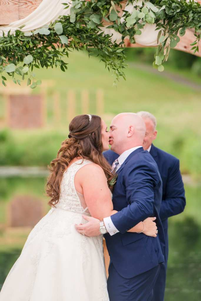 first kiss as husband and wife, Bear Brook Valley wedding, Maggie Sottero gown, The Mane Loft, Nova Fashions, custom grooms attire