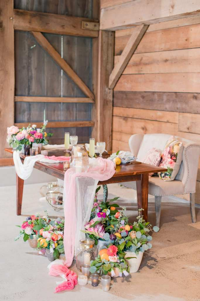Updike Farmstead wedding, Updike wedding, rustic Princeton wedding, NJ wedding photographer, loveseat sweetheart table, rustic sweetheart table, farm to table floral design, incorporating citrus in wedding decor, New Jersey wedding photographer