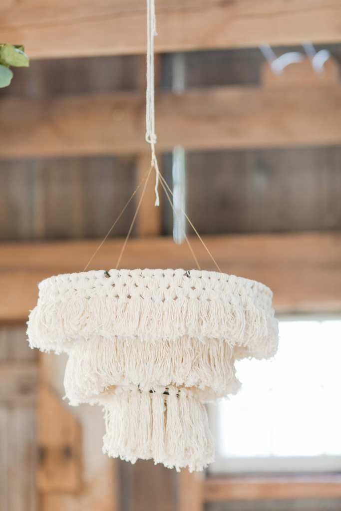 Incorporating unique chandelier into wedding reception, macrame chandelier, anthropologie wedding inspiration