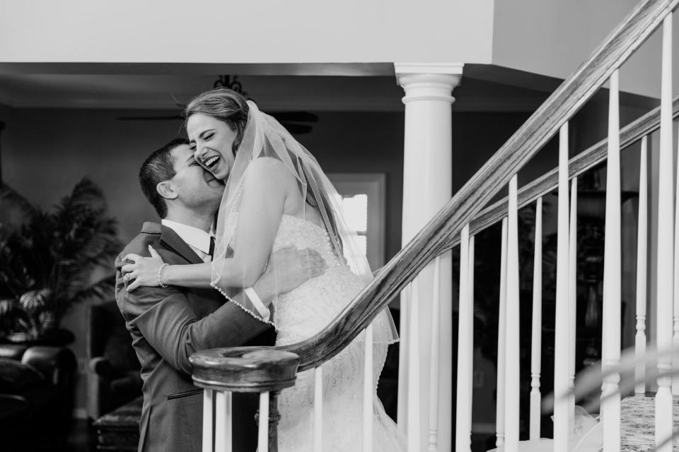 groom embraces his bride, the first embrace of groom and bride after first look, black and white photo, New Jersey wedding photographer