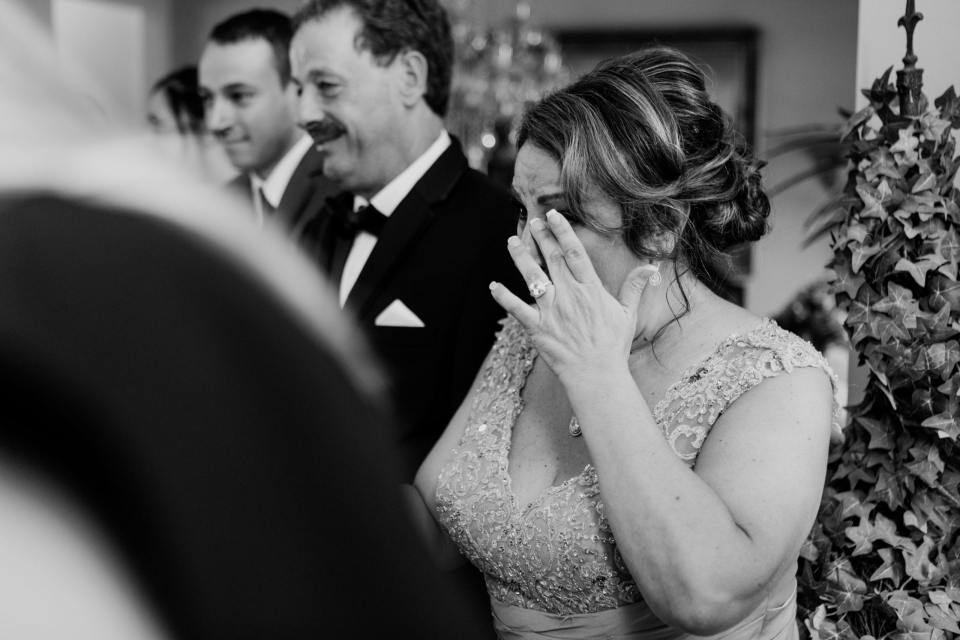 mother of the bride candid moment, black and white photo