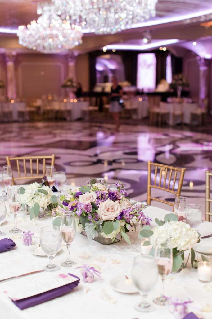 reception details, low classic floral centerpiece, pink and purple roses