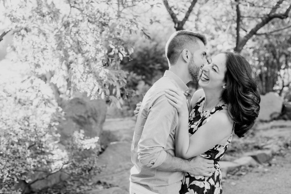 Sayen Gardens weddings, black and white engagement session, hes telling her a secret love photo, NJ wedding photographer