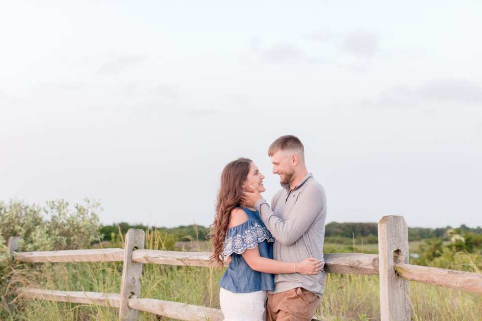 casual beach engagement session, beach dune engagement photo