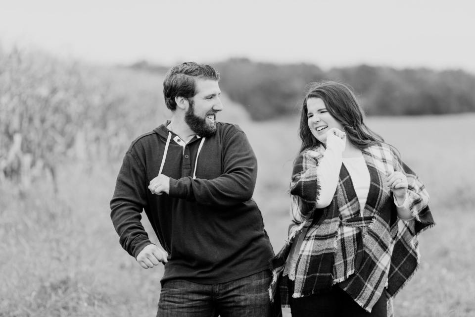 engaged couples having fun session, black and white photos