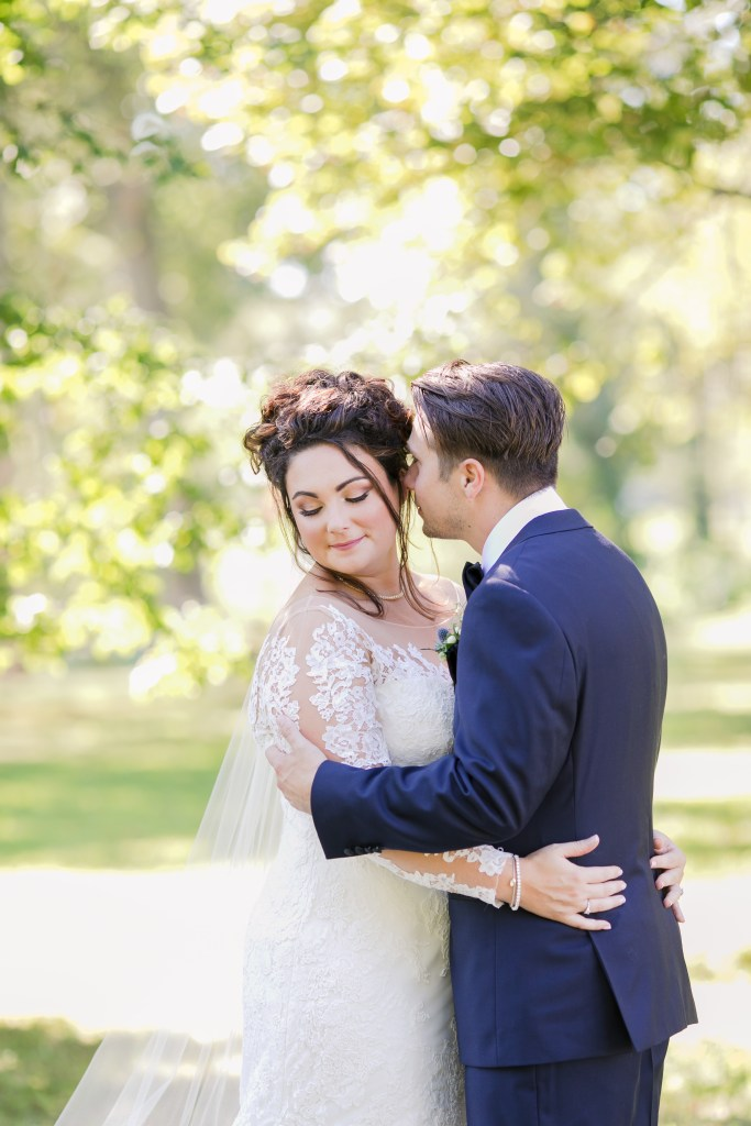 groom whispers into brides ear, bride and groom photo, outdoor bride and groom photo