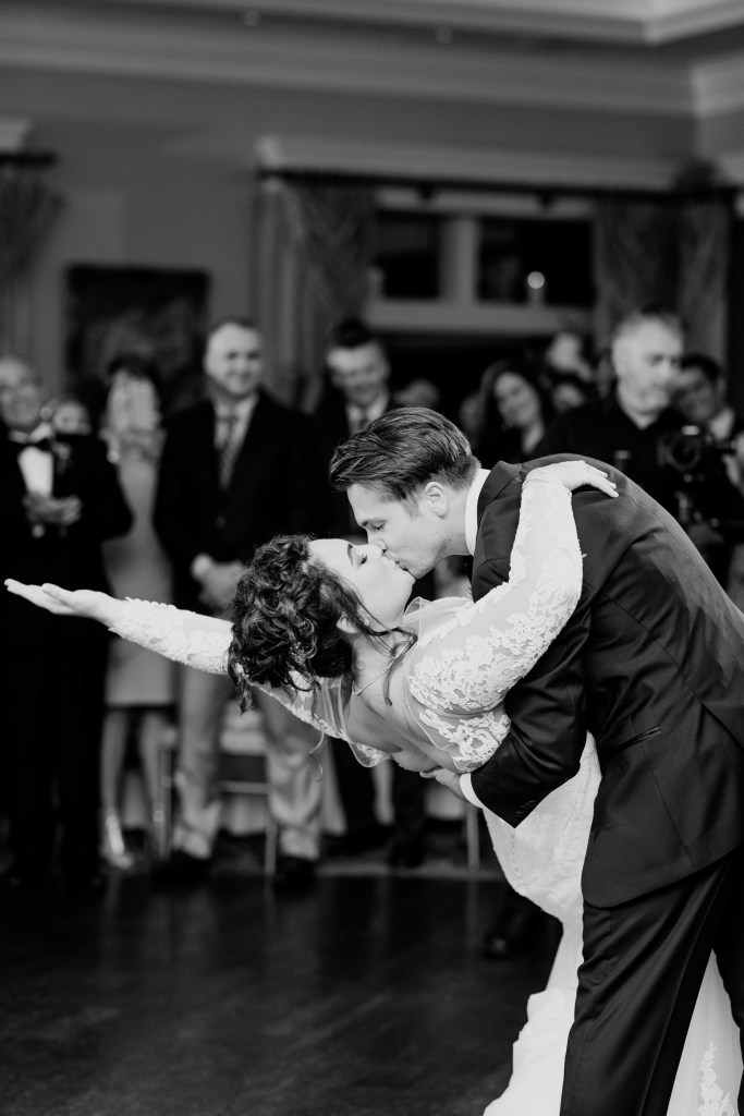 first dance black and white photo, husband and wife first dance kiss, husband and wife first dance dip black and white photo