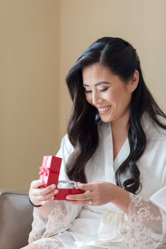 opening grooms gift, special moment between bride and groom