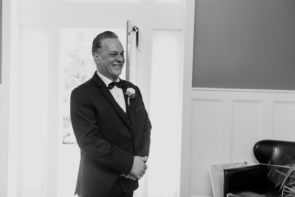 father of the bride black and white candid