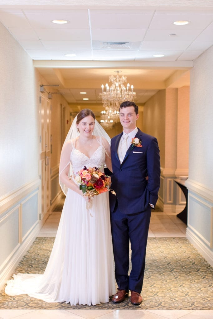 full length formal portrait of bride and groom
