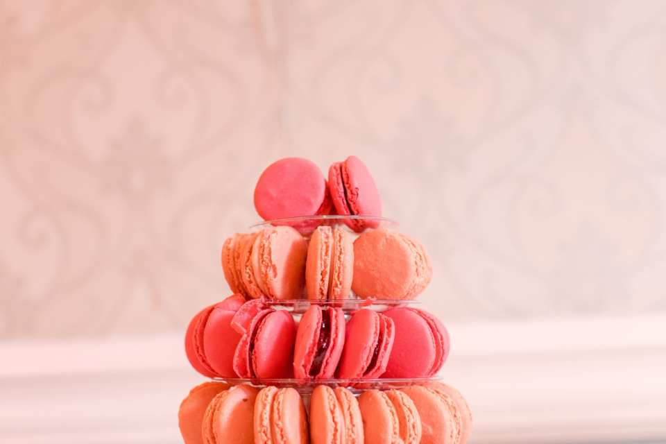 orange and raspberry colored macarons