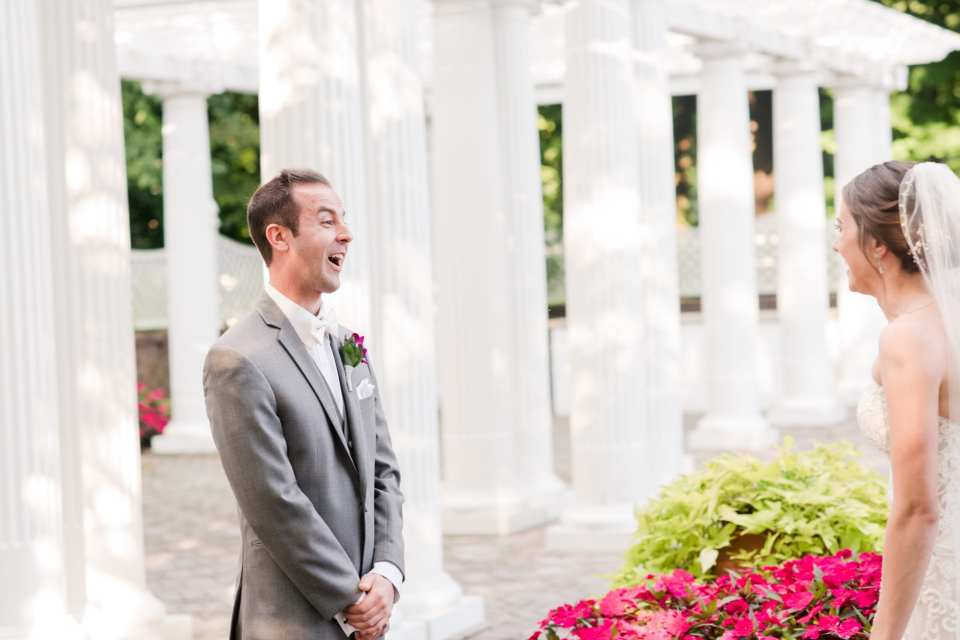 Bride and groom outdoors in the gardens of Shadowbrook at Shrewsbury during the first look