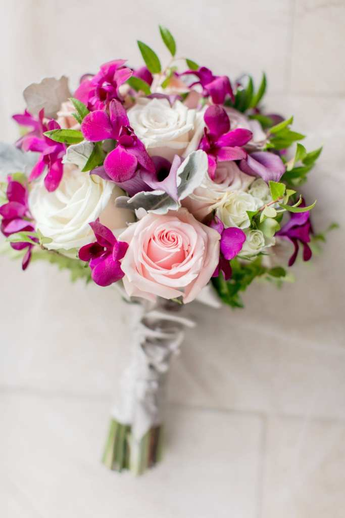 bouquet of pink and cream roses with fuschia orchids