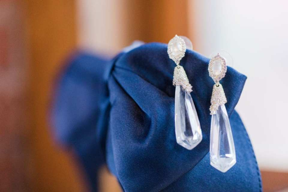 brides crystal drop earings on navy blue fabric