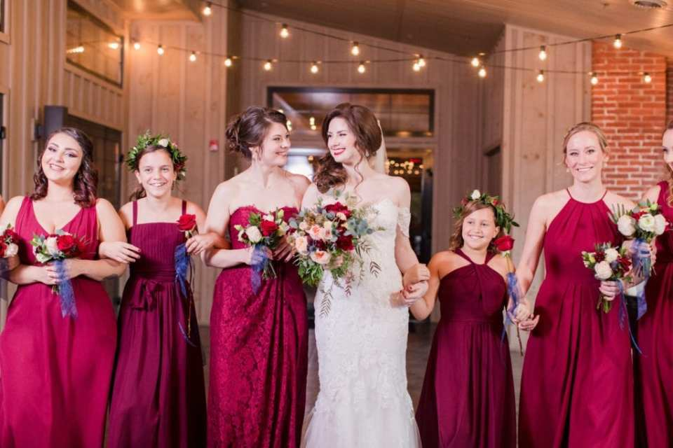 sweet photo of bride and bridal party arms hooked