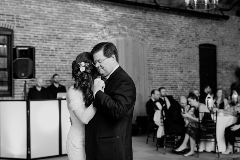 black and white photo of bride and father dancing the father daughter dance