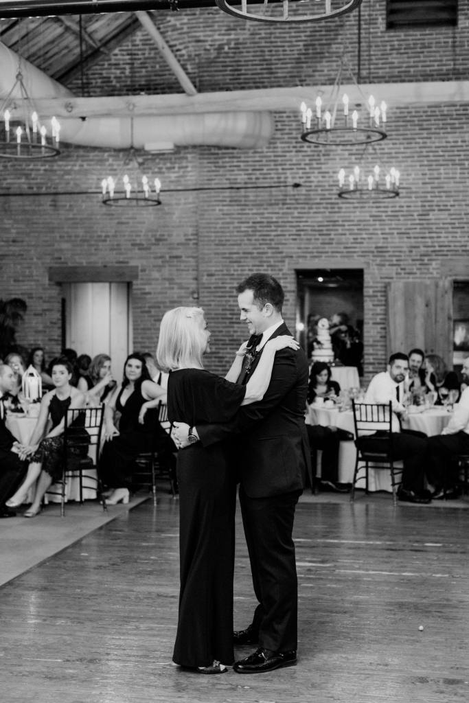 black and white photo of groom and his mother dancing during son and mother dance