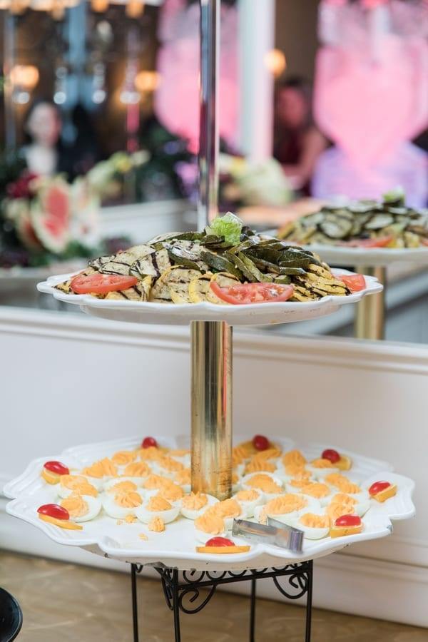 food displays during cocktail hour of grilled veggies and deviled eggs