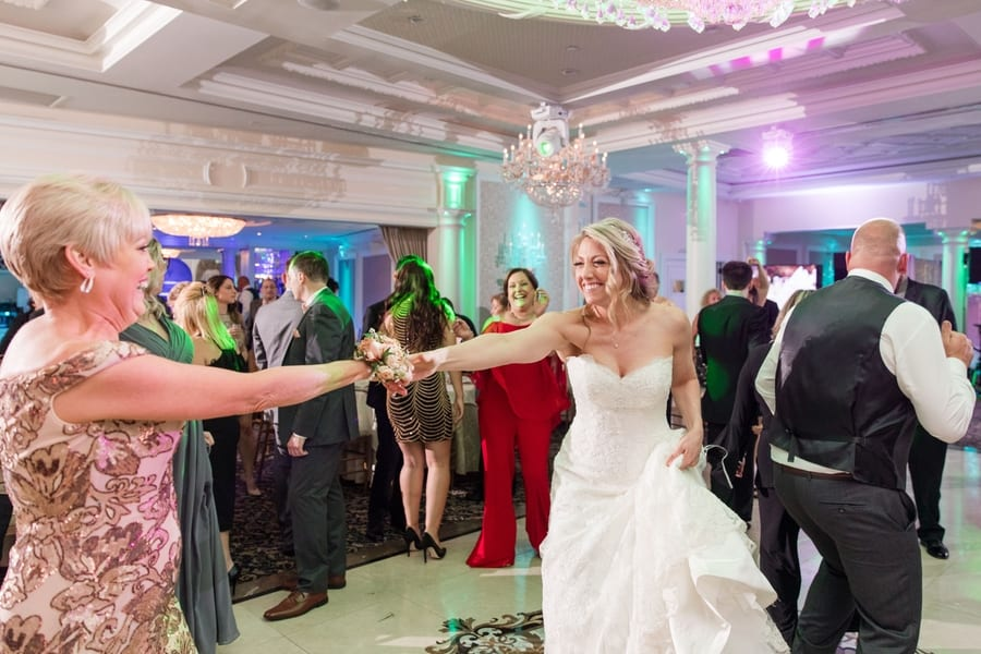 bride dancing with her mom during the reception
