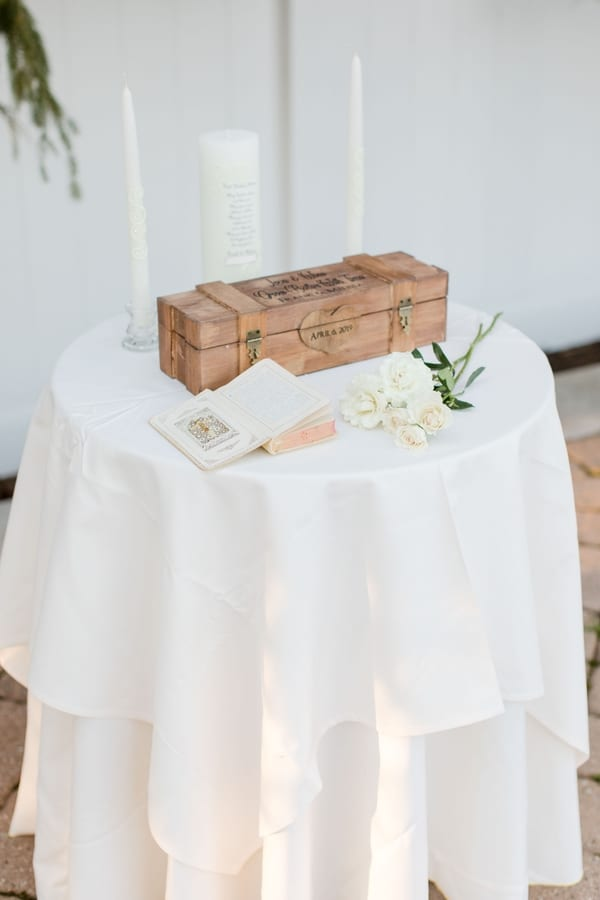 ceremony table of wine box, bible, roses and unity candle