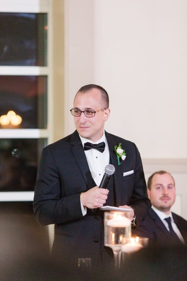 best man makes his speech during toasts