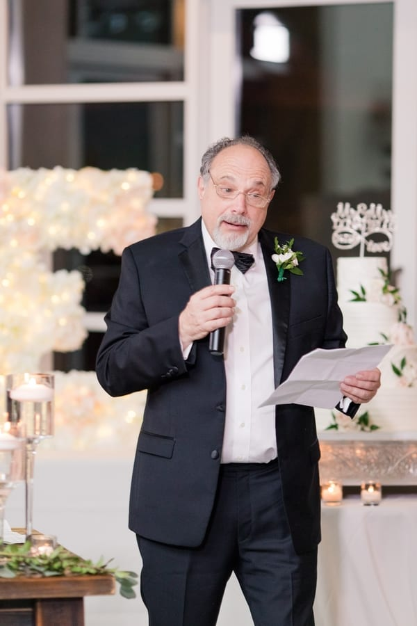 father of the bride makes a speech during the wedding toasts