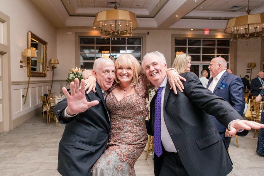 three older guests at the reception dance