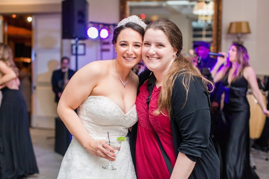 bride and photographer smiling for a picture together