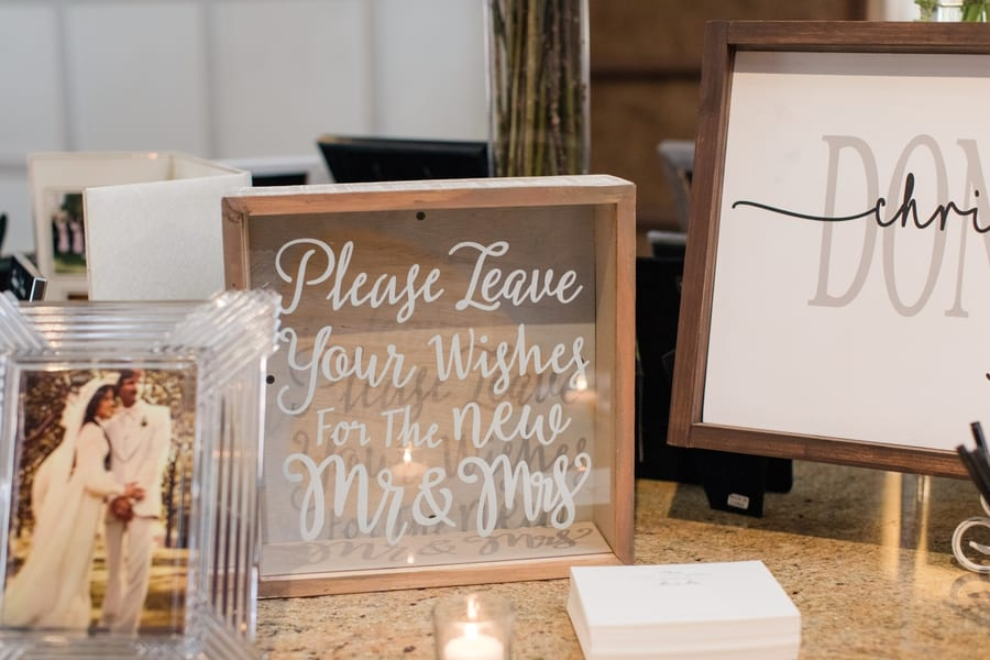 display of family wedding photos with wish card and card holder
