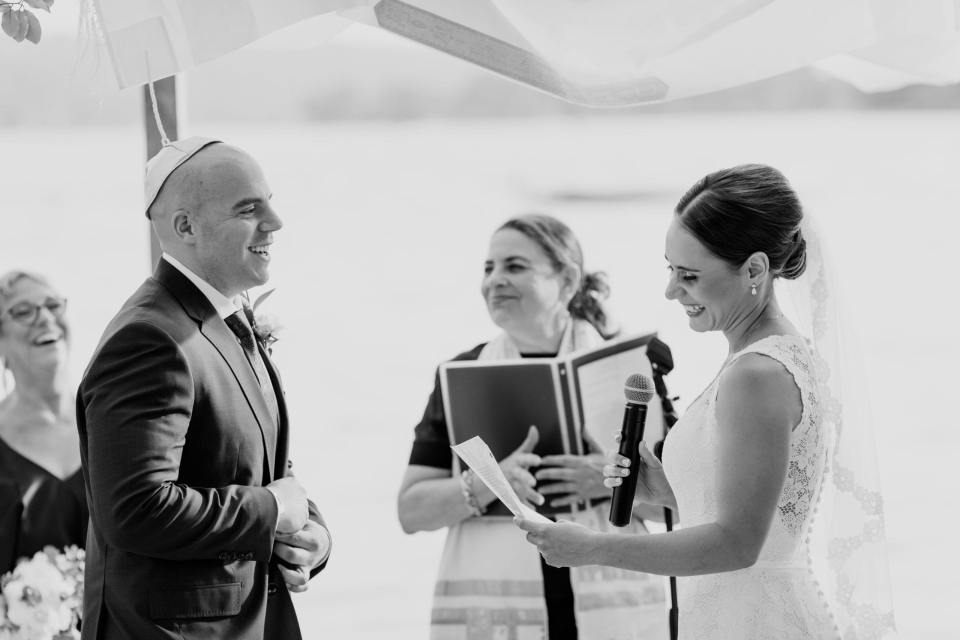 black and white photo of the bride and groom exchanging vows
