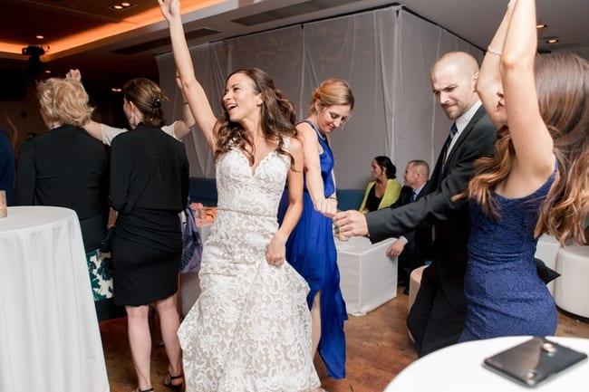 The bride dances with her guests during the wedding reception