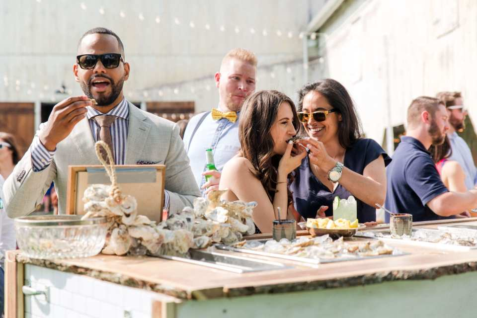 guests enjoying the oyster bar outside the barn on the Updike Farmstead
