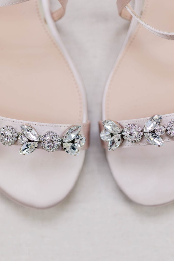 Close up of the jewels on the brides shoes by Badgley Mischka