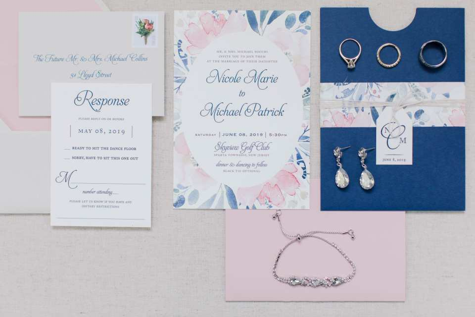 The invitation suite in pink and navy with the rings, and her bridal jewelery