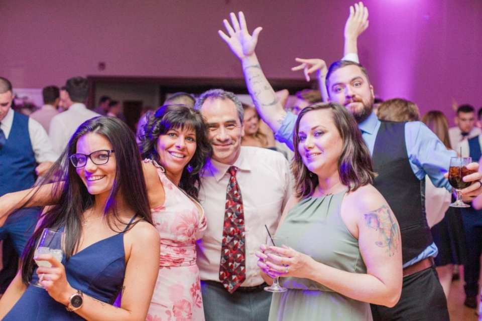 Guests pose informally during the reception